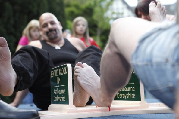 Toe wrestling Championships in Ashbourne, UK
