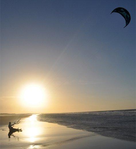 Kitesurfing at sunset in Jericoacoara, Brazil
