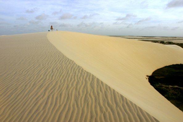 horseback riding on the beautiful sand dunes of Jericoacoara, Brazil